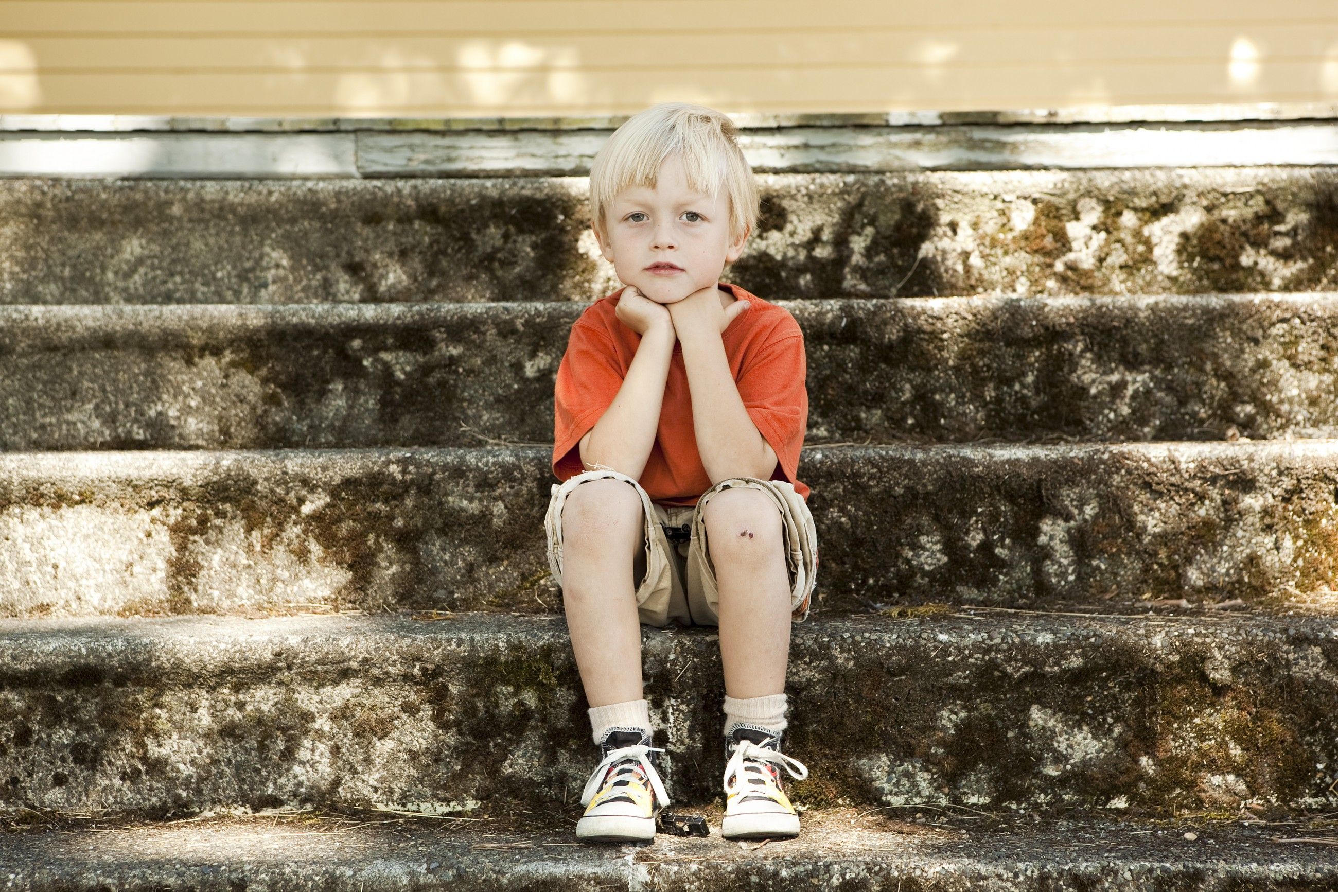 CASA boy on steps
