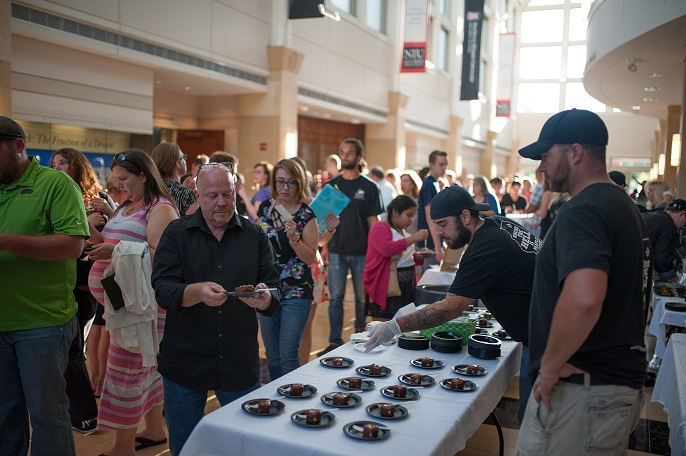 Guests sampling food at the event