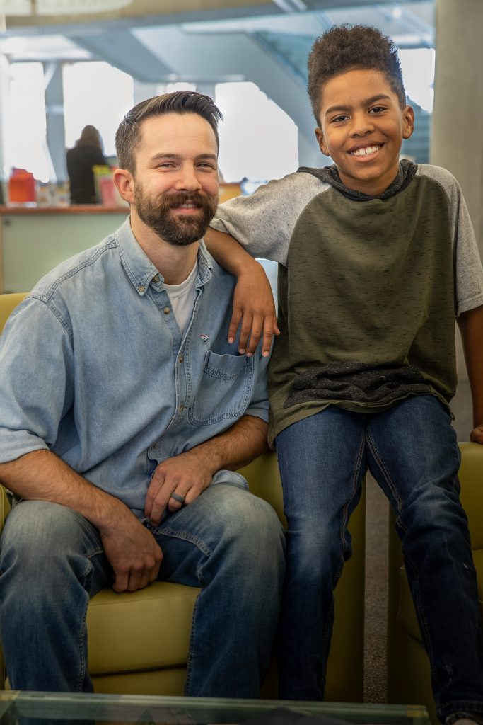 Male advocate with pre-teen boy.